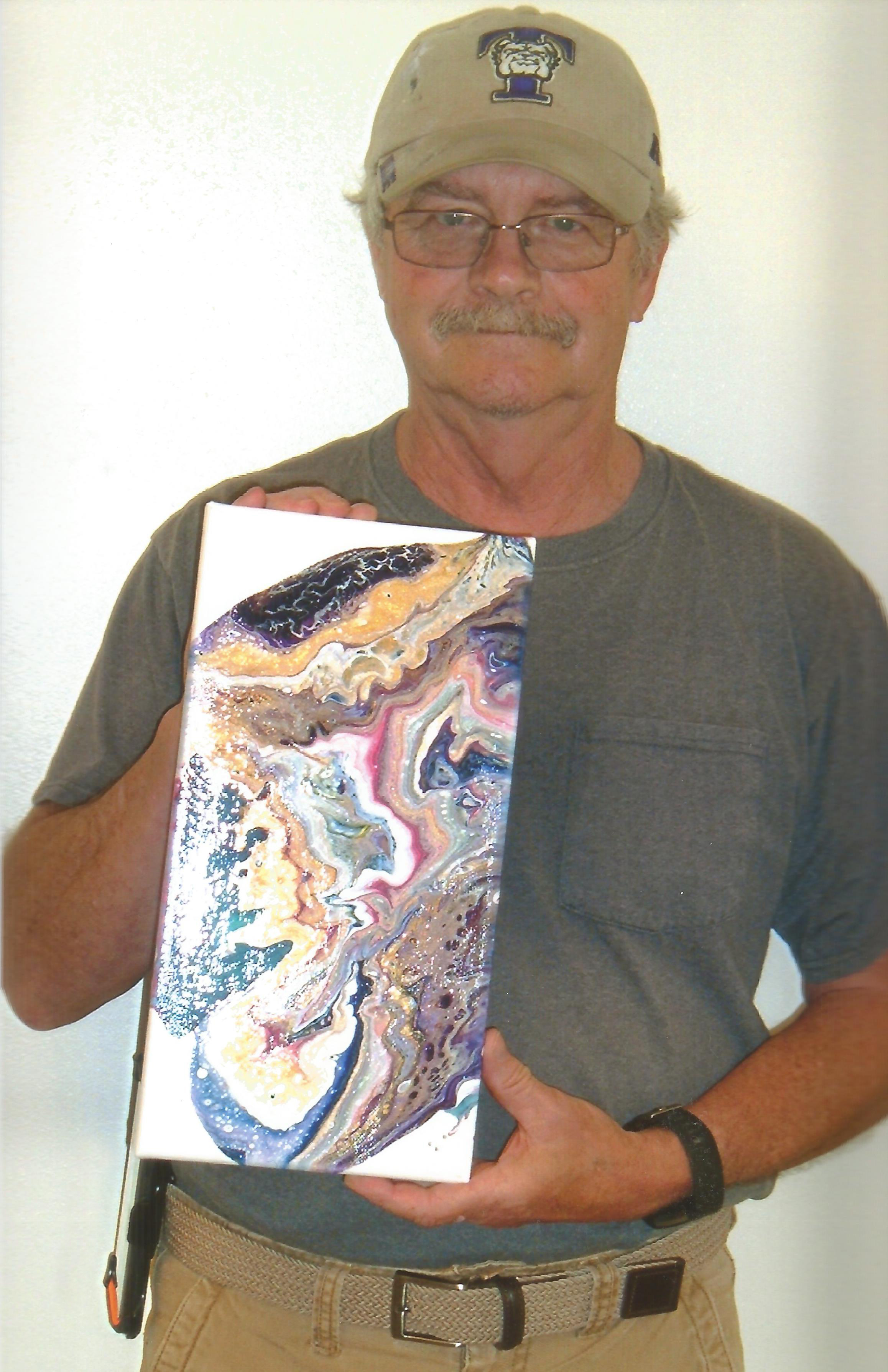 "Greg Walter with his piece ""Geode"""
